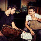 Stjepan and Luka (2 Cellos) holding carbon fiber briefcase