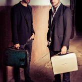 A-case carborn fiber briefcase in hand of 2 Cellos