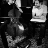 Stjepan Hauser holding A-case carbonfiber briefcase listening Luka's playing Cello